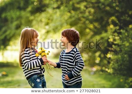 genç · kız · çiçekler · gülen · sevmek · mutlu - stok fotoğraf © monkey_business