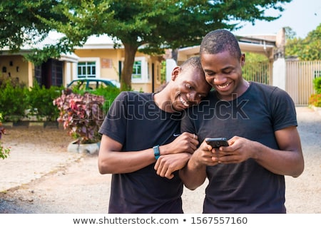 Happy Gay Couple Using Social Media On Mobile Phone Stock photo © diego_cervo