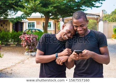 Mutlu eşcinsel çift sosyal medya cep telefonu eşcinsel Stok fotoğraf © diego_cervo