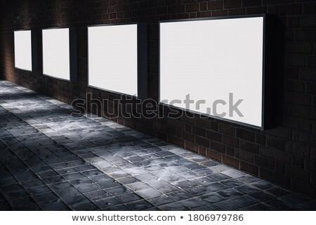 market news on white brick wall stock photo © tashatuvango