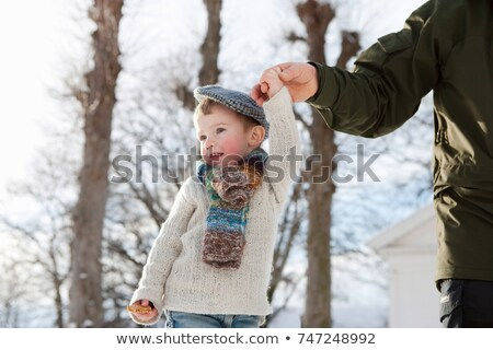 Scandinavian boy guided by fathers hand Stock photo © IS2