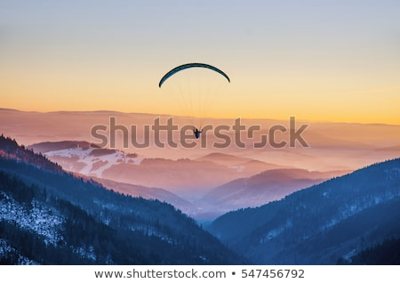 Paraglide Over Mountains Stock photo © FOTOYOU