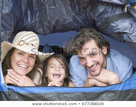 family lying inside tent laughing stock photo © is2