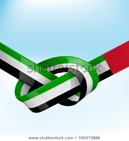 united arab emirates ribbon flag on bue sky background Stock photo © doomko