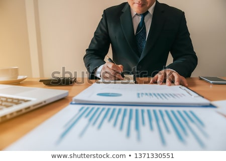 Business man working at office with laptop, tablet and graph dat Stock photo © snowing