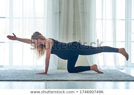 Terhes nő gyakorol jóga testmozgás otthon terhesség Stock fotó © stevanovicigor