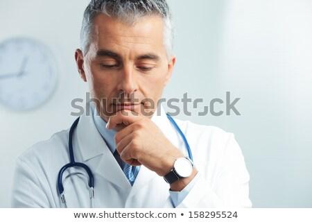 Pense médecin portrait souriant jeunes Homme Photo stock © Jasminko