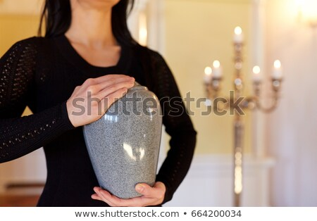 close up of woman and cremation urn in church Stock photo © dolgachov