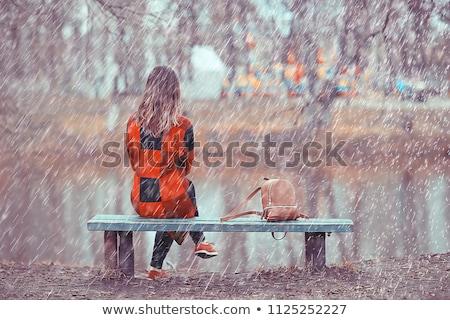 Stock photo: Beautiful sad woman under the rain