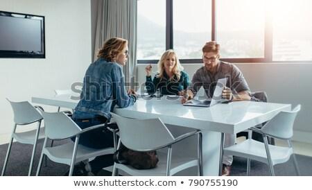Trzy osoby spotkanie biuro okno biznesmen pracy Zdjęcia stock © IS2