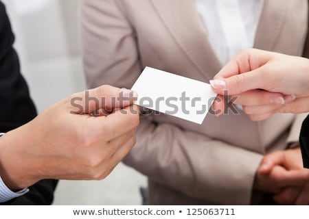 Businesspeople exchanging business cards Stock photo © IS2