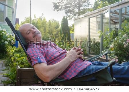 Senior Adult man lying on sun lounger Stock photo © IS2
