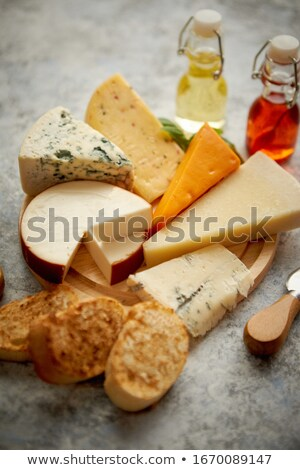 Various types of cheese served on rustic wooden board Stock photo © dash
