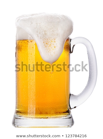 Cold glass of lager ale beer with foam and dew Stock photo © DenisMArt