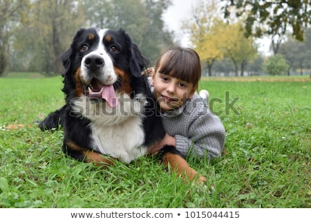 children and pet in the park stock photo © bluering