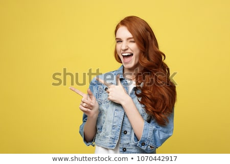 portrait of a cheerful young girl presenting copy space stock photo © deandrobot