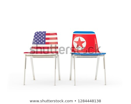 Stock photo: Two chairs with flags of US and north korea isolated on white