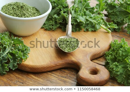 Chopped dry kale leaves on rustic background Stock photo © Virgin