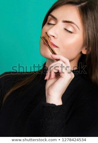 Cinnamon sticks in female hands on a background of spices Stock photo © galitskaya