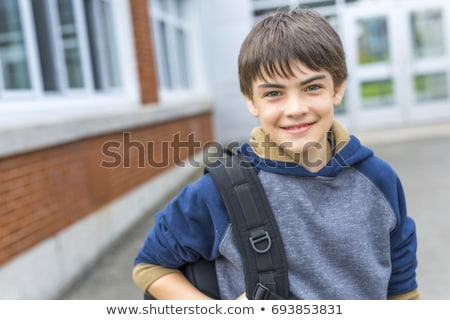 nice pre teen boy outside at school having good time stock photo © lopolo