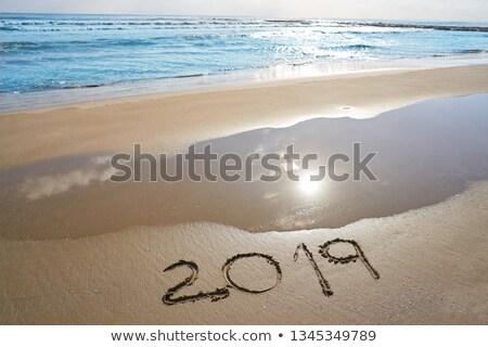 year 2019 numbers spell written on beach Stock photo © lunamarina
