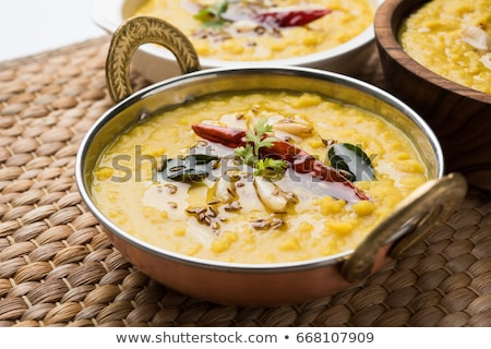 Indian popular food Dal fry or traditional Dal Tadka Curry served in bowl Stock photo © dash
