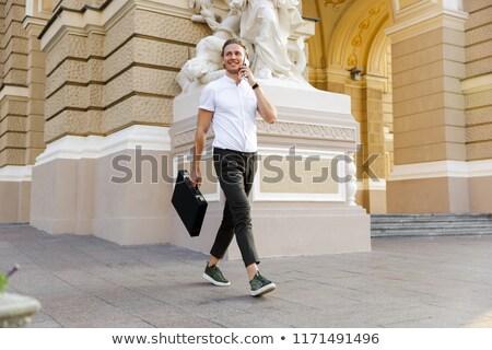 Afbeelding gelukkig gekruld zakenman aktetas Stockfoto © deandrobot