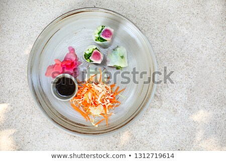 Rolls with seared tuna with green salad on white plate  Stock photo © dashapetrenko