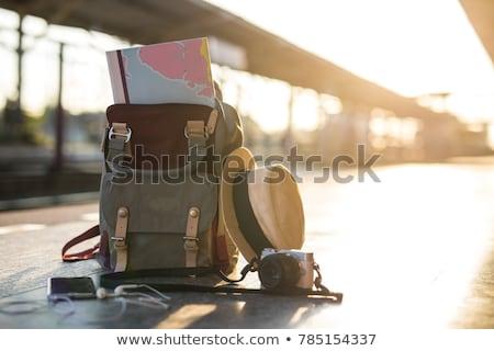 Sırt çantası genç güzel bir kadın bakıyor gün batımı Stok fotoğraf © choreograph