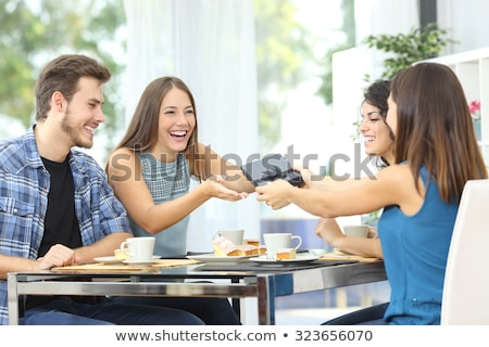 Friends loving couples holding boxes with food and drinks. Stock photo © deandrobot