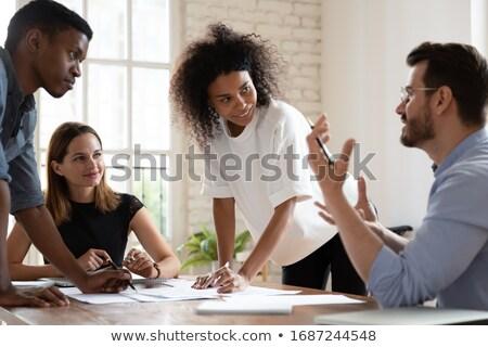Négy fiatal kollégák konferencia tárgyaló megbeszélés Stock fotó © pressmaster