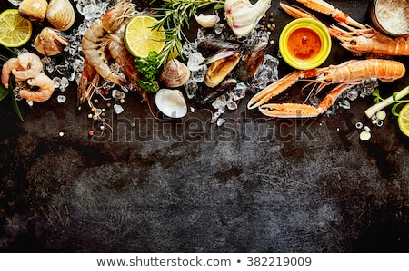 Fresh seafood. Langostino shrimps Stock photo © karandaev