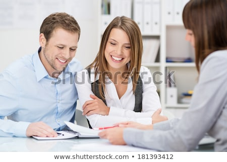 Young couple in a meeting - insurance or bank for investments Stock photo © Lopolo
