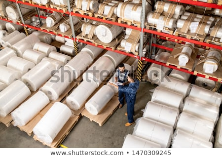 Two young technical experts in workwear discussing working moments at meeting Stock photo © pressmaster