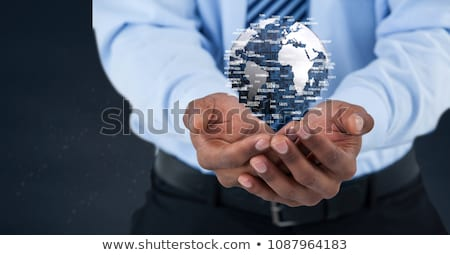 Hand holding a globe with connectors Stock photo © wavebreak_media