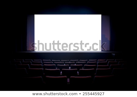empty cinema hall with white screen and red chairs stock photo © loopall