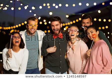 happy friends with party props at rooftop Stock photo © dolgachov