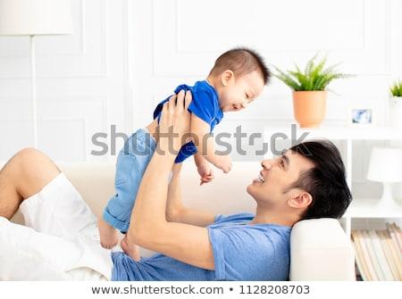 Padre baby divano bene tempo Foto d'archivio © Lopolo