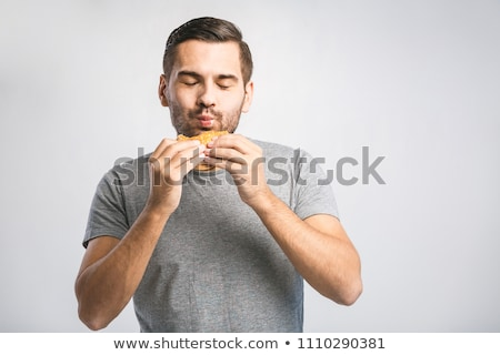 Young man eating hamburger man eating junk food, fatty food hamburger Stock photo © galitskaya