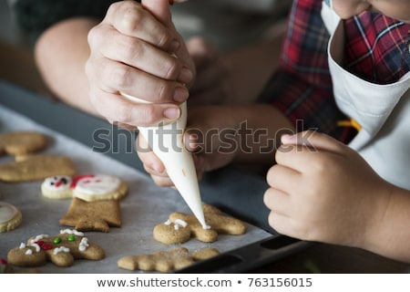 man with christmas cookies in his hands Stock photo © nito