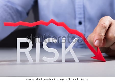 Person Pointing Diminishing Arrow Over The Risk Stock photo © AndreyPopov