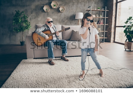 Young family singing and playing music at home Stock photo © Elnur
