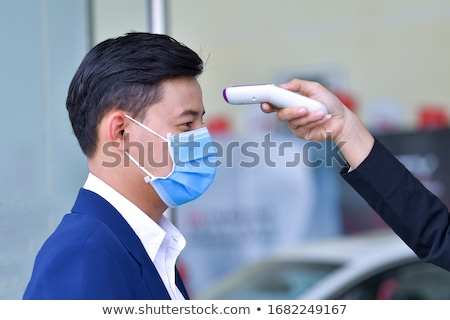 Airport Temperature Check Protected From Covid 19 Stock photo © AndreyPopov