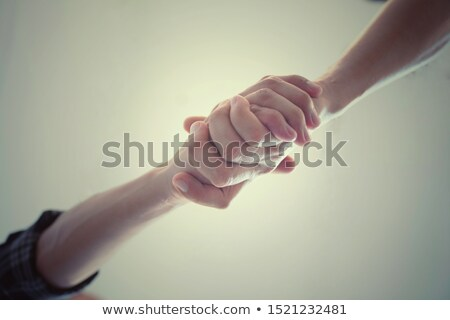 Hand shake between two persons isolated on white Stock photo © experimental