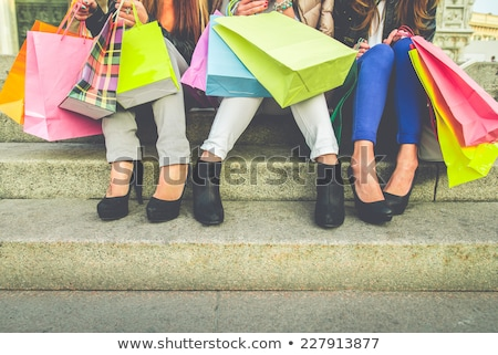 Three girls with colorful shopping bags Stock photo © RuslanOmega