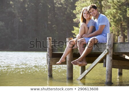 Portre romantik çiftler oturma ahşap iskele Stok fotoğraf © vichie81