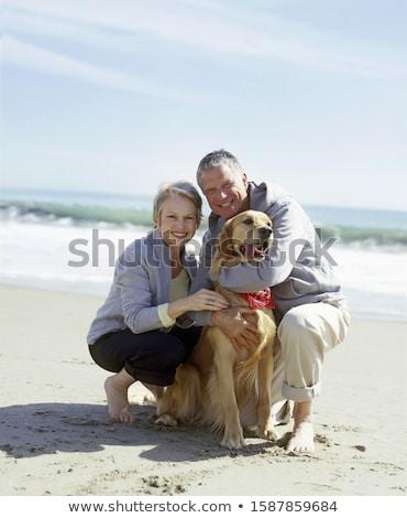 couple happy posing with golden retirever dog stock photo © lunamarina