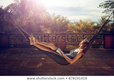 kobieta · hamak · fali · młodych · sam - zdjęcia stock © iofoto