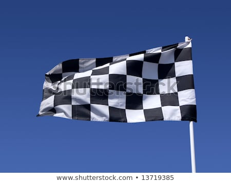 a checkered flag blowing in the wind at the end of a motor race stock photo © latent