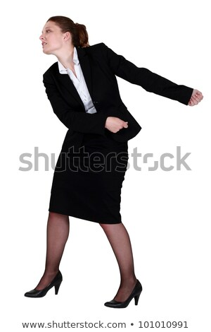 Businesswoman pulling an invisible chain Stock photo © photography33